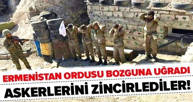 Bozguna uğrayan Ermenistan ordusu askerlerini mevzilere zincirliyor .