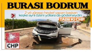 Bodrum'da asfalt yarıldı, cip içine düştü